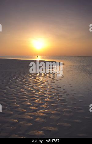 Beautiful Sunset Sunrise on the paradise Islands of the Maldives - Stock Photo