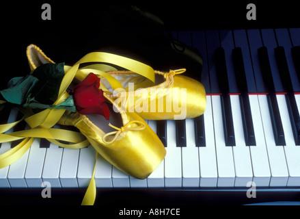 Ballet slippers on keyboard - Stock Photo