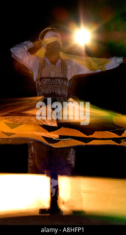 Whirling Egyptian dancer Red Sea Coast Sinai Egypt - Stock Photo