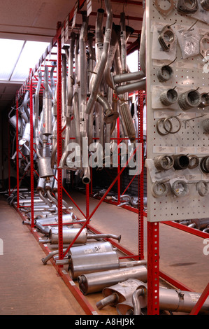 Carparts store warehouse with spare parts for cars exhaust silencing device red - Stock Photo
