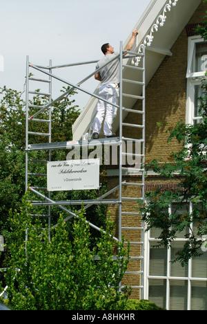 Men At Work On Scaffold And Ladder Rossland British