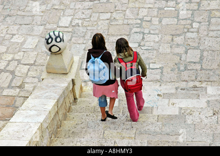 School kids with rucksack going down stairs, two friends, Graffiti, Alicante, Spain - Stock Photo