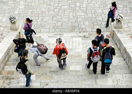 School kids with rucksack going down stairs, Graffiti, Alicante, Spain - Stock Photo