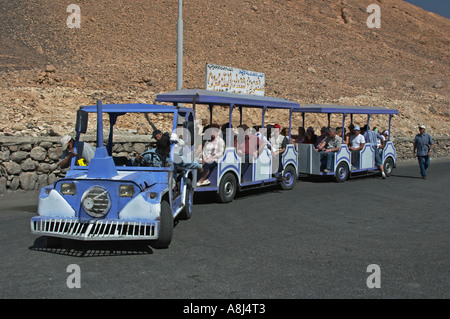 Trolley bus used to take tourists from the parking lot to Queen Hatshepsut's Temple - Stock Photo