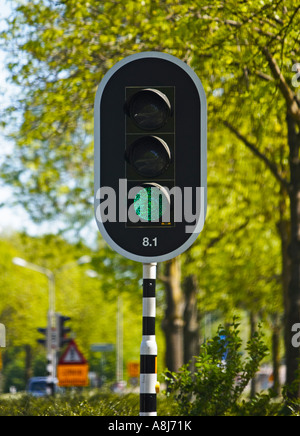 Traffic light signals on green - Stock Photo