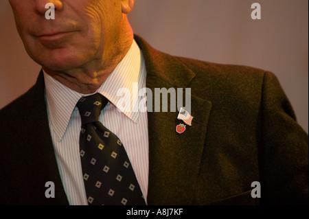 New York City Mayor Michael Bloomberg Big Apple and American lapel pins USA Feb 2006 - Stock Photo