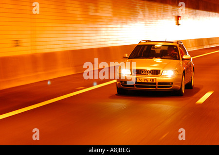 Audi S4 wagon car V6 Biturbo engine 2000 2001 Germany drving on the road in tunnel A4 Quarter with smooth background - Stock Photo
