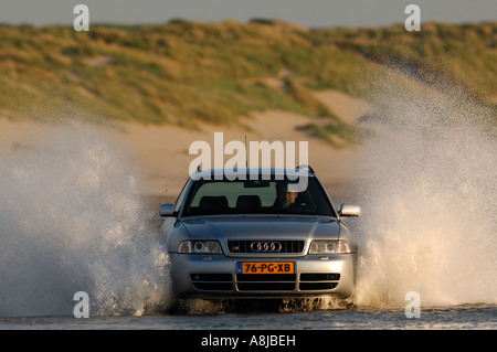 Audi S4 wagon car V6 Biturbo engine 2000 2001 Germany in full action on the beach A4 Quarter speeding brake - Stock Photo