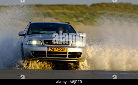 Audi S4 wagon car V6 Biturbo engine 2000 2001 Germany in full action on the beach A4 Quarter coming out the water - Stock Photo