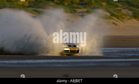 Audi S4 wagon car V6 Biturbo engine 2000 2001 Germany in full action on the beach A4 Quarter side shot headhigh - Stock Photo