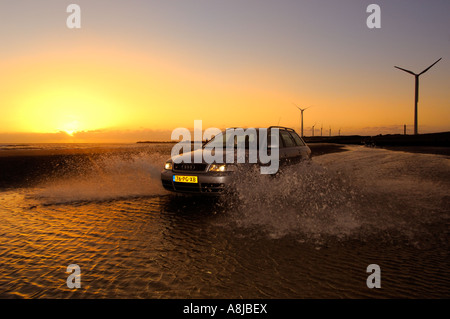 Audi S4 wagon car V6 Biturbo engine 2000 2001 Germany in full action on the beach A4 Quarter sunset driving beach - Stock Photo