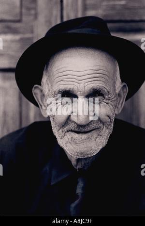 Character B+W portrait study of happy elderly Canary gentleman in Vegueta, Las Palmas, Canary Islands Spain - Stock Photo