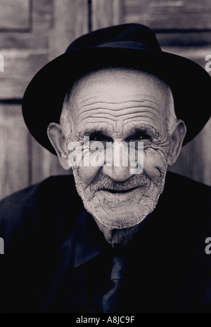 Lined Character Face Hispanic Elderly man & hat Portrait Outdoors  B+W happy elderly Spanish Canary gentleman Vegueta - Stock Photo