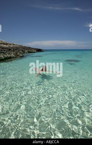 Woman in water on uninhabited island Elbow Cay Cay Sal Bank Bahamas Islands - Stock Photo