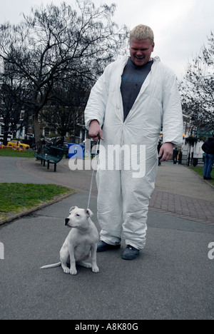 Man and his Staffordshire terrier looking alike - Stock Photo