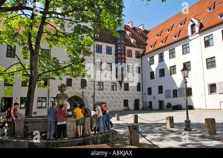 Fountain with children in the old courtyard of the Residence, Munich, Bavaria, Germany - Stock Photo