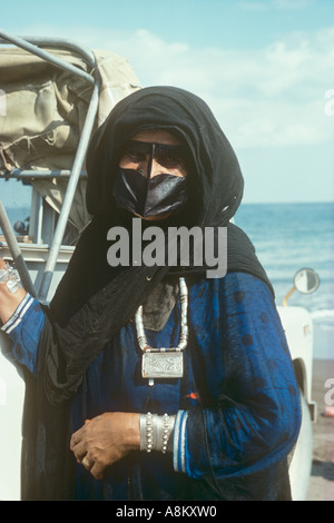 Muslim woman wearing traditional costume and jewellery, Batinah Coast of Oman - Stock Photo