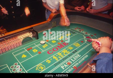 Gambling a game of craps Las Vegas Nevada USA - Stock Photo