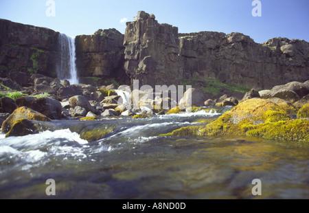 Waterfall Öxararfoss in Thingvellir Canyon Iceland - Stock Photo