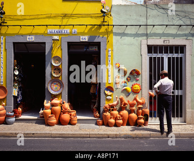 Village pottery shop with bright yellow frontage in the traditional Portuguese Algarve village of Silves. Credit: - Stock Photo
