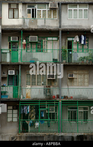 Old residential buildings located in the wealthy Central business district in Hong Kong - Stock Photo