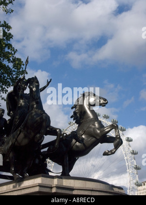 Statue of Queen Boadicea of the Iceni by Thomas Thornycroft and the London Eye London England history historic tourist - Stock Photo