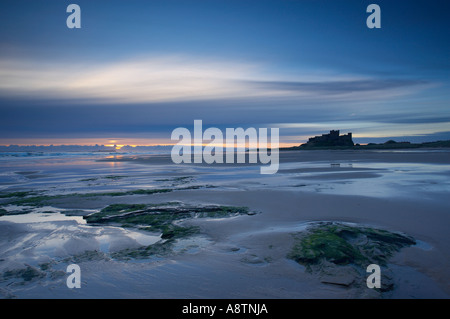 dawn on the beach at Bamburgh Castle Northumbria England UK - Stock Photo