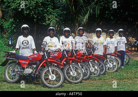 Training session for Ghanaian nurses. Wearing  health sloganed tee shirts they will use motorcycles to reach outlying - Stock Photo