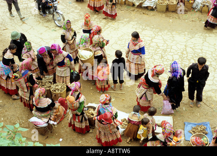 Overhead view of crowd of traditionally dressed Flower Hmong women, at Saturday market, Can Cau, NW Viet Nam - Stock Photo
