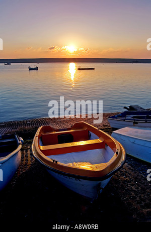 Old Rowing Boats by Sea During Sunset at Portland near Weymouth in Dorset - Stock Photo
