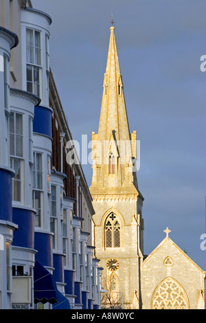 Late afternoon early evening sun setting on the spire and steeple of church in Weymouth Dorset in England - Stock Photo