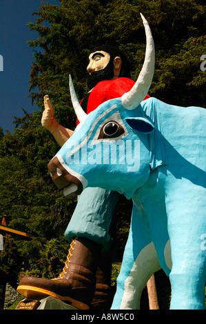 The Trees of Mystery statues of Paul Bunyan and his Blue Ox Babe stand out front near the Redwoods State and National - Stock Photo