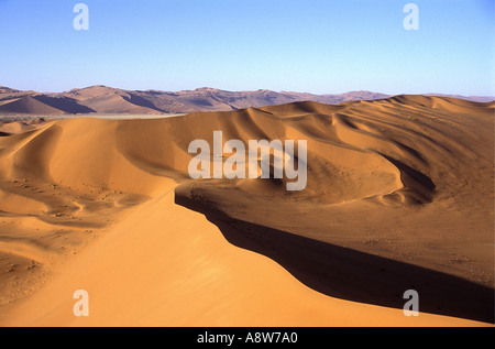 View from the summit of Big Daddy near Sossusvlei in the Namib Naukluft National Park Namibia south west Africa - Stock Photo