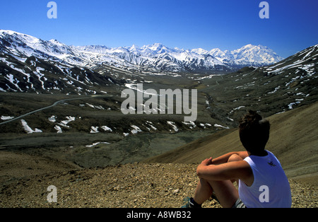 Hiker views Mt McKinley Denali from Stony Hill Denali National Park Alaska MR - Stock Photo