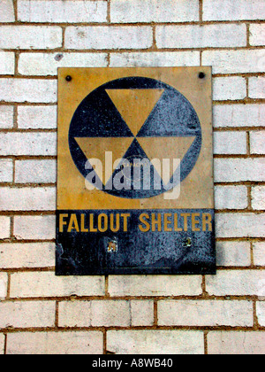 A Fallout Shelter sign circa 1963 still on the side of a building The signs were placed outside of buildings that - Stock Photo