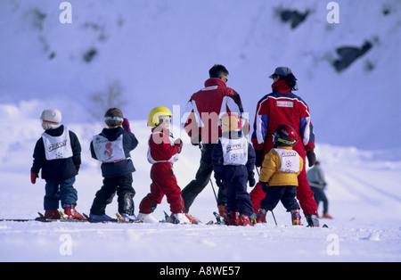 Two ski instructors with a childrens ski school le tour argentiere chamonix france - Stock Photo