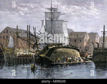 Whaling ship hove down for hull repairs in New Bedford Massachusetts 1800s. Hand-colored woodcut - Stock Photo