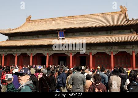 Tourists inside Forbidden City, Beijing China - Stock Photo