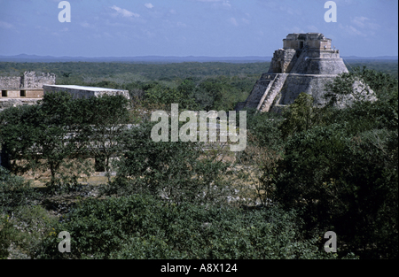 Uxmal, Mexico - The Mayan ruins of the Pyramid Of The Magician seen from Nunnery Quadrangle, Uxmal, Yucatan, Mexico - Stock Photo