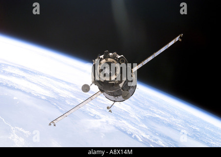 Soyuz spacecraft approaches the Pirs docking compartment on the International Space Station - Stock Photo