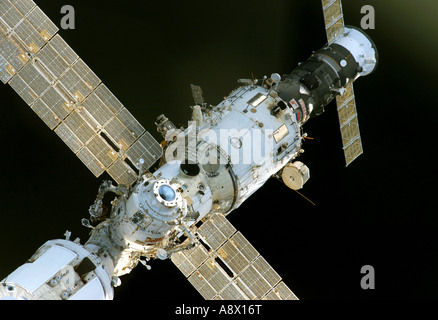 The International Space Station and the Space Shuttle Discovery begin their relative separation - Stock Photo