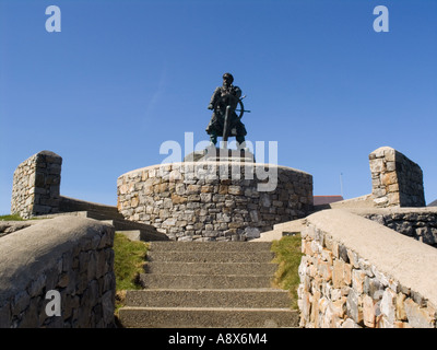 Bronze Statue of Coxswain Richard Dic Evans 1905-2001 at top of steps against blue sky. Moelfre Anglesey North Wales - Stock Photo