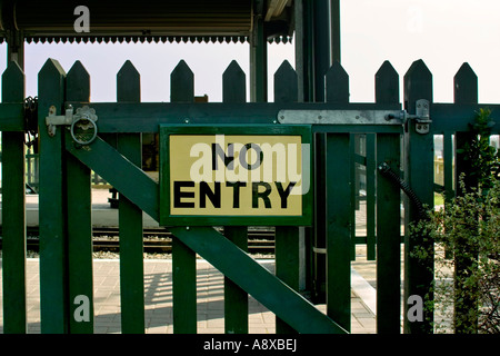 no entry sign on locked wooden gate - Stock Photo