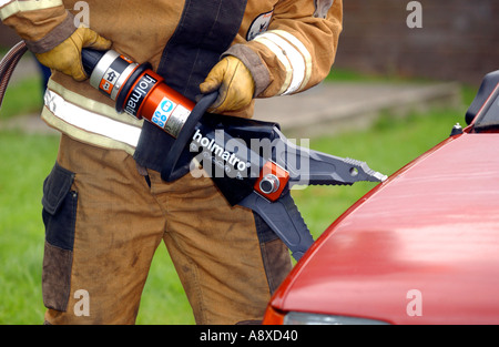 Firefighters cut open a car during a training drill - Stock Photo