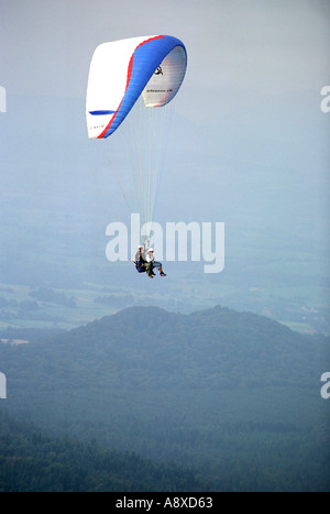 Tandem paragliding at Puy de Dome in the Auvergne region of France - Stock Photo