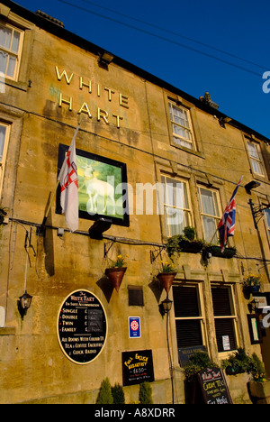 stow on the wold town centre the cotswolds gloucestershire the midlands england uk white hart pub - Stock Photo