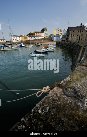 Fishing boats and pleasure yachts moored in Tenby harbour at high tide, Wales UK, summer afternoon - Stock Photo