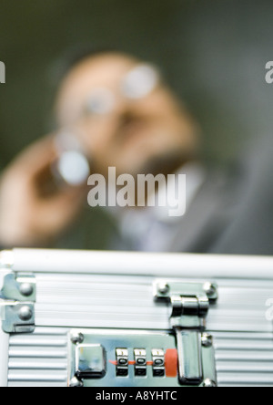 Combination lock on briefcase, extreme close-up - Stock Photo