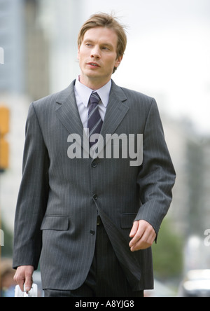 Young businessman walking - Stock Photo