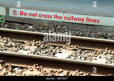Pisa Central Railway station Tuscany Italy do not cross sign on track - Stock Photo
